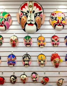Usually, there is a gift shop that sells items related to the show, like these masks that represent the characters