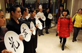 Staff encouraging conscious consumption in Qingdao, Shandong Province (english.sina.com)